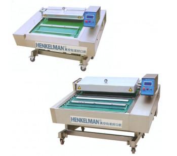 广东粮食连续式真空封口包装机,深圳音像制品连动真空包装机